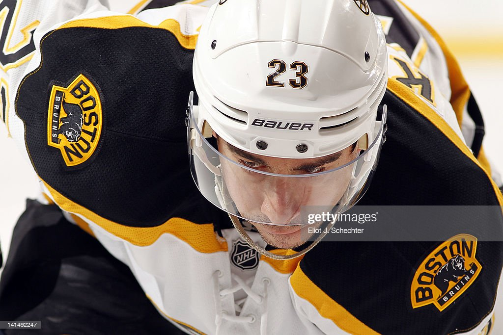 Chris Kelly of the Boston Bruins faces off against the Florida Panthers at the BankAtlantic Center on March 15 2012 in Sunrise Florida