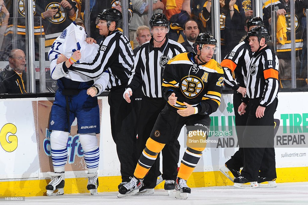 Chris Kelly #23 of the Boston Bruins is sent to the locker room after getting physical against <a gi-track='captionPersonalityLinkClicked' href=/galleries/search?phrase=Leo+Komarov&family=editorial&specificpeople=883027 ng-click='$event.stopPropagation()'>Leo Komarov</a> #47 of the Toronto Maple Leafs in Game One of the Eastern Conference Quarterfinals during the 2013 NHL Stanley Cup Playoffs at TD Garden on May 1, 2013 in Boston, Massachusetts.