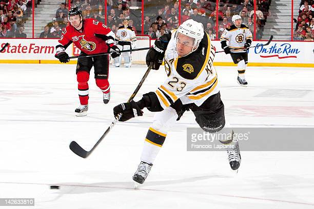 Chris Kelly of the Boston Bruins shoots the puck against the Ottawa Senators at Scotiabank Place on April 5 2012 in Ottawa Ontario Canada