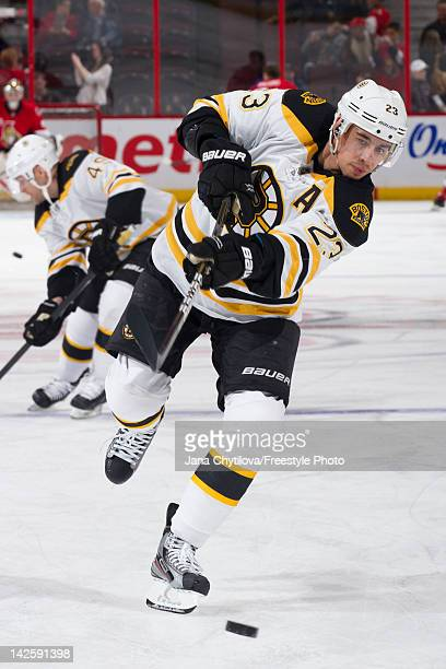 Chris Kelly of the Boston Bruins shoots the puck during the warmup skate prior to an NHL game against the Ottawa Senators at Scotiabank Place on...