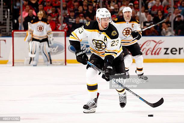 Chris Kelly of the Boston Bruins skates with the puck against the Florida Panthers at the BBT Center on October 30 2015 in Sunrise Florida