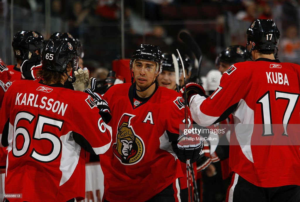 Chris Kelly of the Ottawa Senators celebrates his goal against the Philadelphia Flyers with teammates Erik Karlsson and Filip Kuba in a game at...
