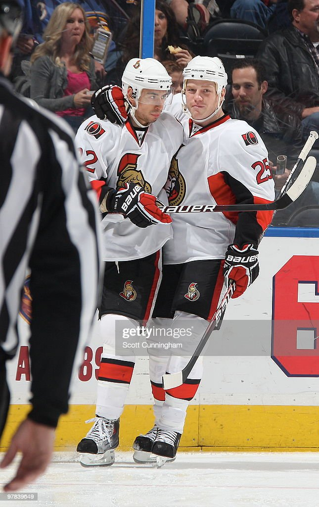 Chris Kelly #22 of the Ottawa Senators is congratulated by Chris Neil #25 after scoring a goal against the Atlanta Thrashers at Philips Arena on March 18, 2010 in Atlanta, Georgia.