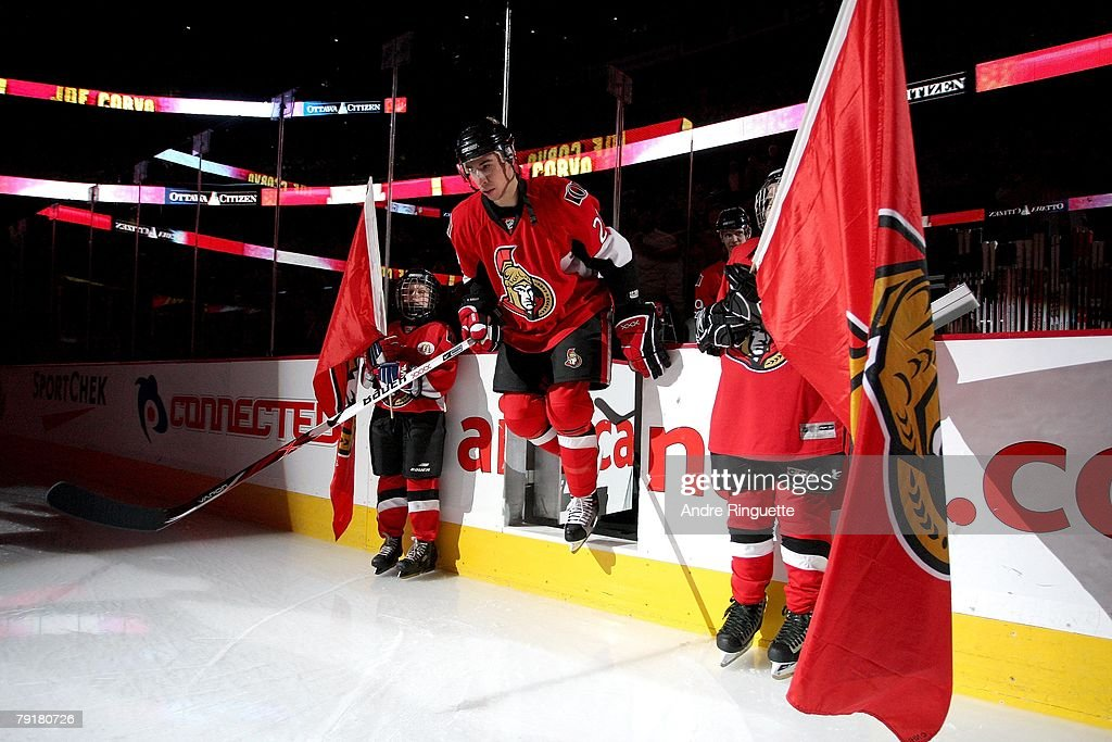 Chris Kelly of the Ottawa Senators steps onto the ice during player intruductions prior to a game against the Tampa Bay Lightning at Scotiabank Place...
