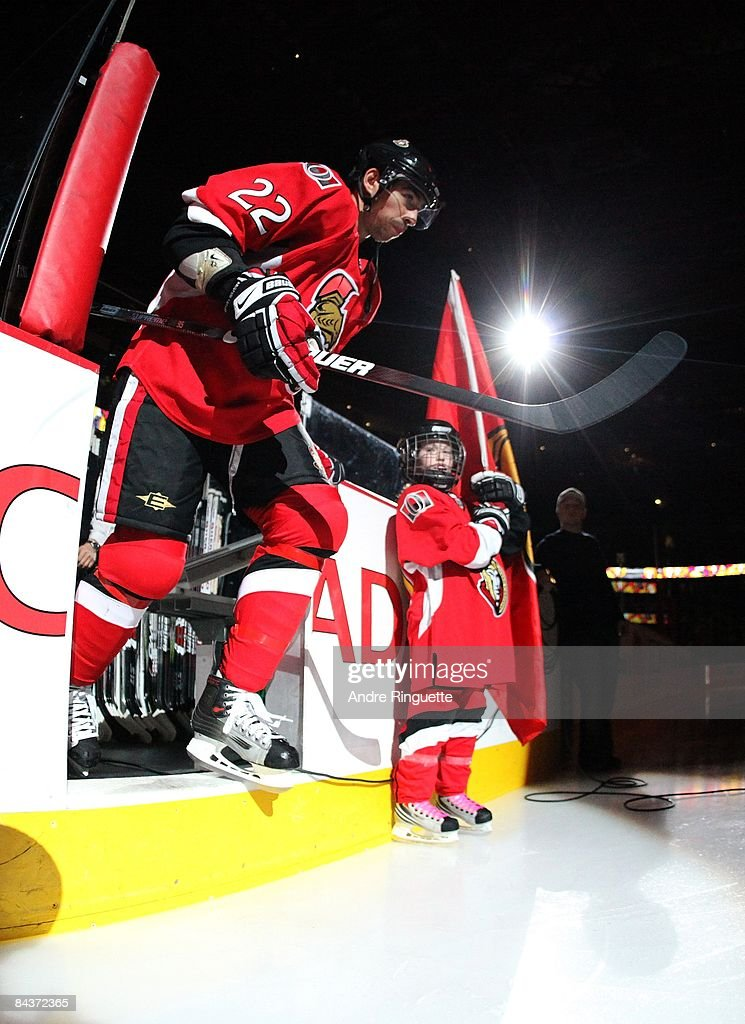 Chris Kelly of the Ottawa Senators steps onto the ice during player introductions prior to a game against the New York Rangers at Scotiabank Place on...
