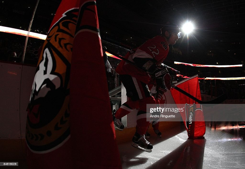 Chris Kelly of the Ottawa Senators steps onto the ice during player introductions prior to a game against the Washington Capitals at Scotiabank Place...