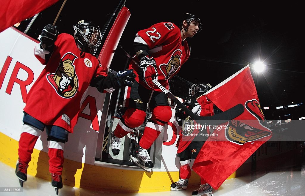 Chris Kelly of the Ottawa Senators steps onto the ice during player introductions prior to a game against the Carolina Hurricanes at Scotiabank Place...