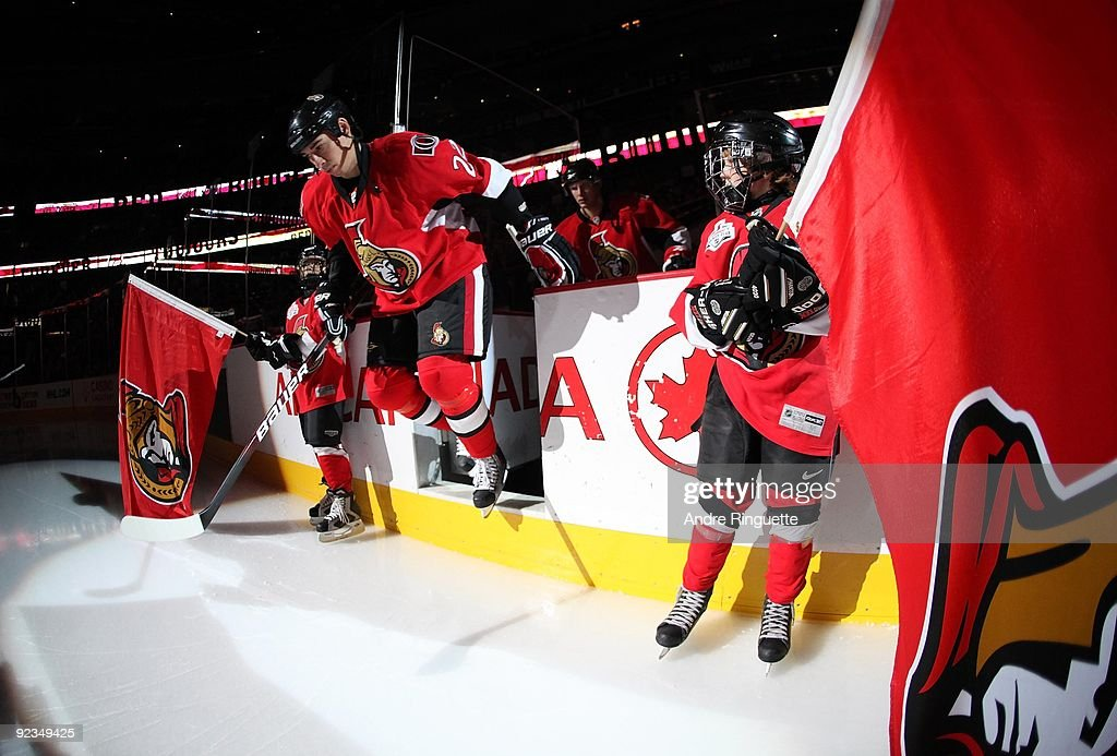 Chris Kelly of the Ottawa Senators steps onto the ice during player introductions prior to a game against the Nashville Predators at Scotiabank Place...