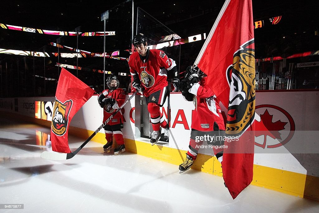 Chris Kelly of the Ottawa Senators steps onto the ice during player introductions prior to a game against the Montreal Canadiens at Scotiabank Place...