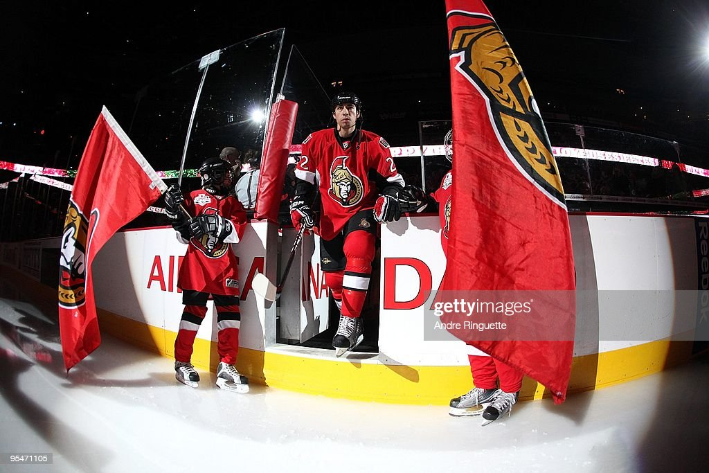 Chris Kelly of the Ottawa Senators steps onto the ice during player introductions prior to a game against the Boston Bruins at Scotiabank Place on...
