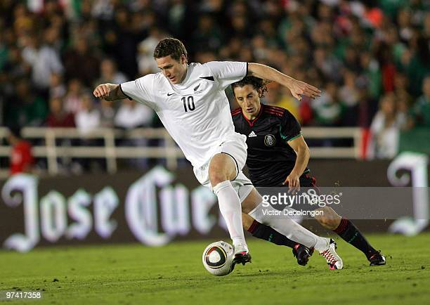 Chris Killen of New Zealand plays the ball through midfield under pressure from Andres Guardado of Mexico in the second half during their...
