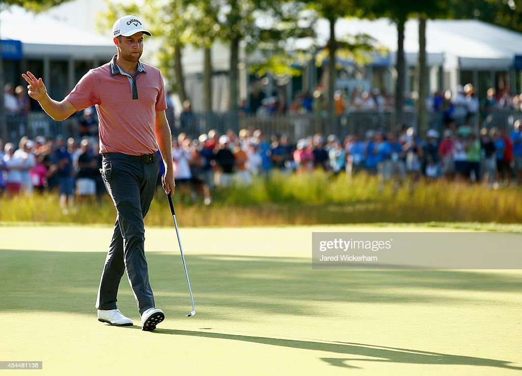 Chris Kirk acknowledges the crowd as he walks on the 16th hole during the final round of the Deutsche Bank Championship at the TPC Boston on...