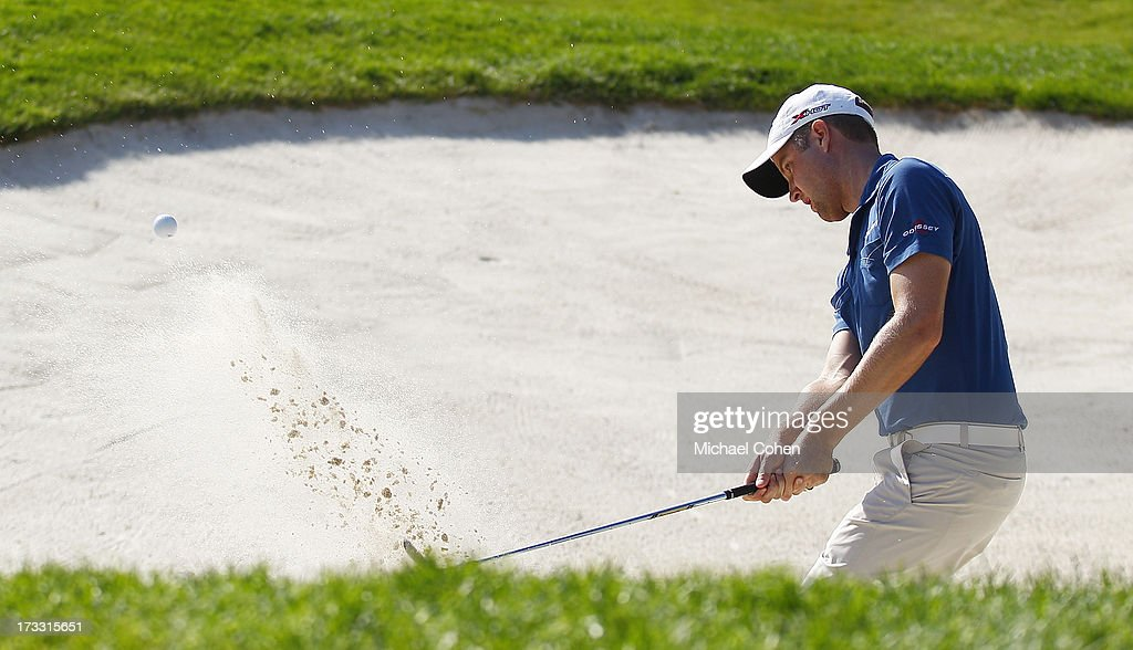 <a gi-track='captionPersonalityLinkClicked' href=/galleries/search?phrase=Chris+Kirk&family=editorial&specificpeople=3973095 ng-click='$event.stopPropagation()'>Chris Kirk</a> hits a shot from a bunker during the first round of the John Deere Classic held at TPC Deere Run on July 11, 2013 in Silvis, Illinois.