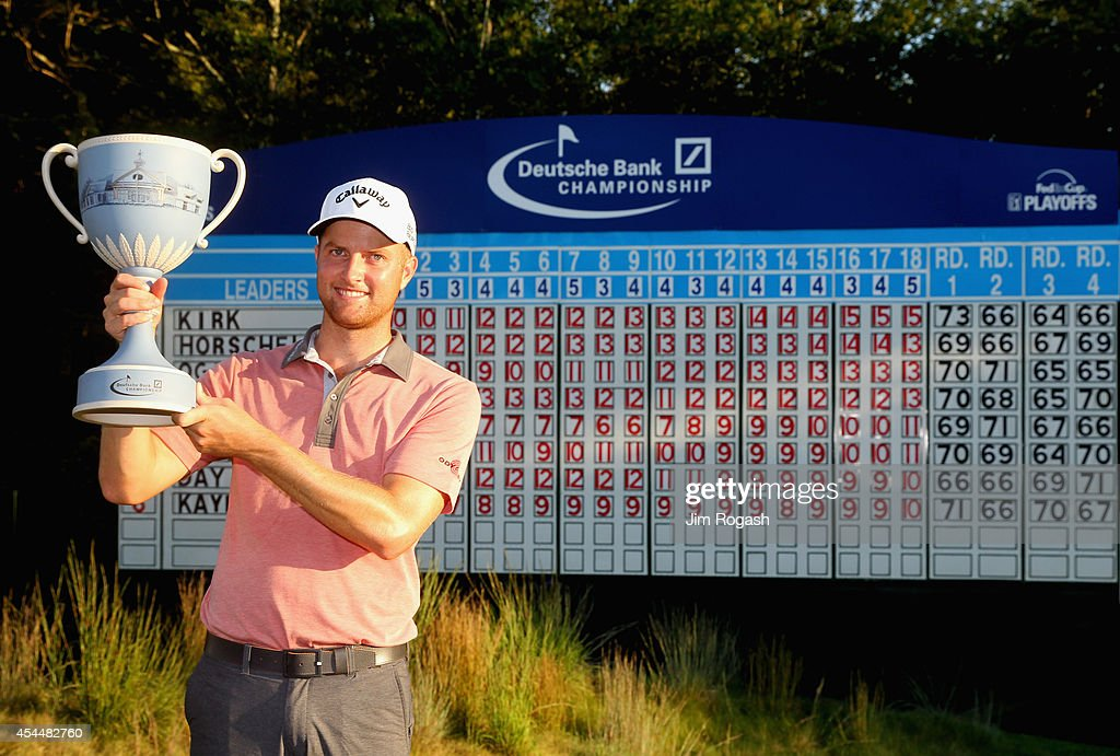 Chris Kirk is presented with the winner's trophy after winning the Deutsche Bank Championship at the TPC Boston on September 1, 2014 in Norton, Massachusetts.