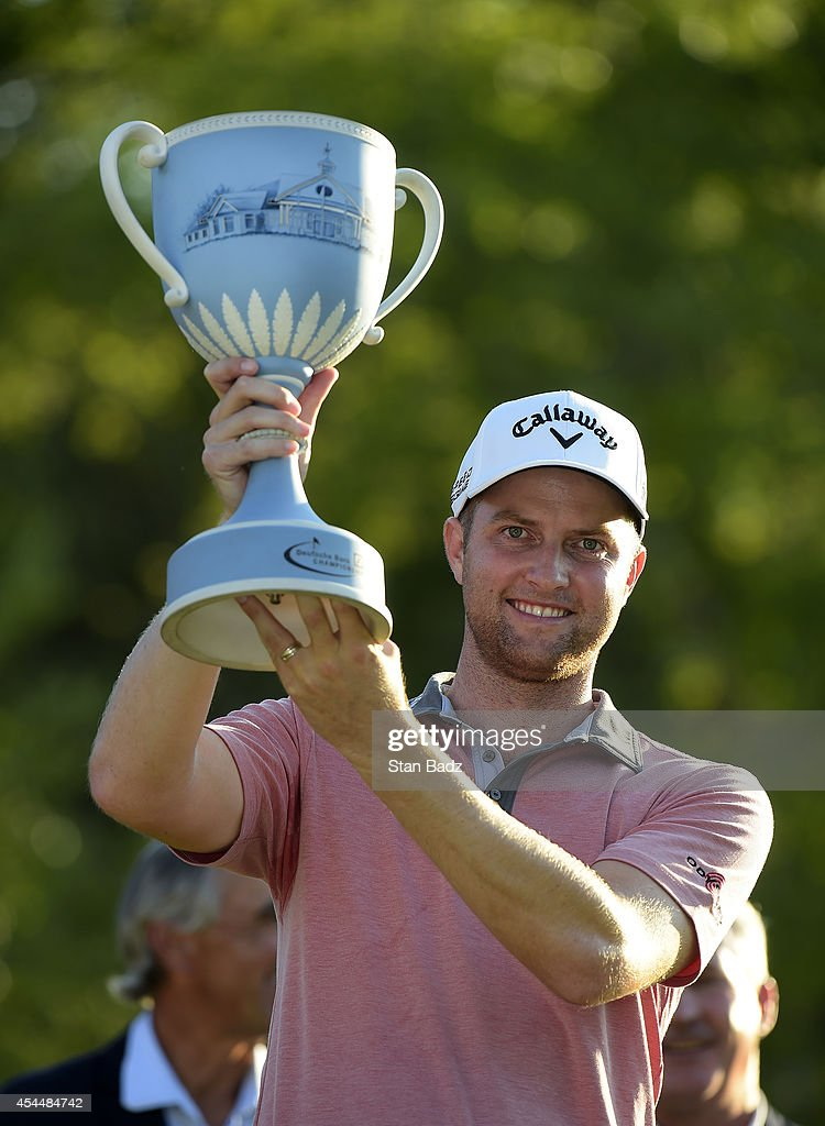 Chris Kirk is presented with the winner's trophy after winning the Deutsche Bank Championship at TPC Boston on September 1, 2014 in Norton, Massachusetts.
