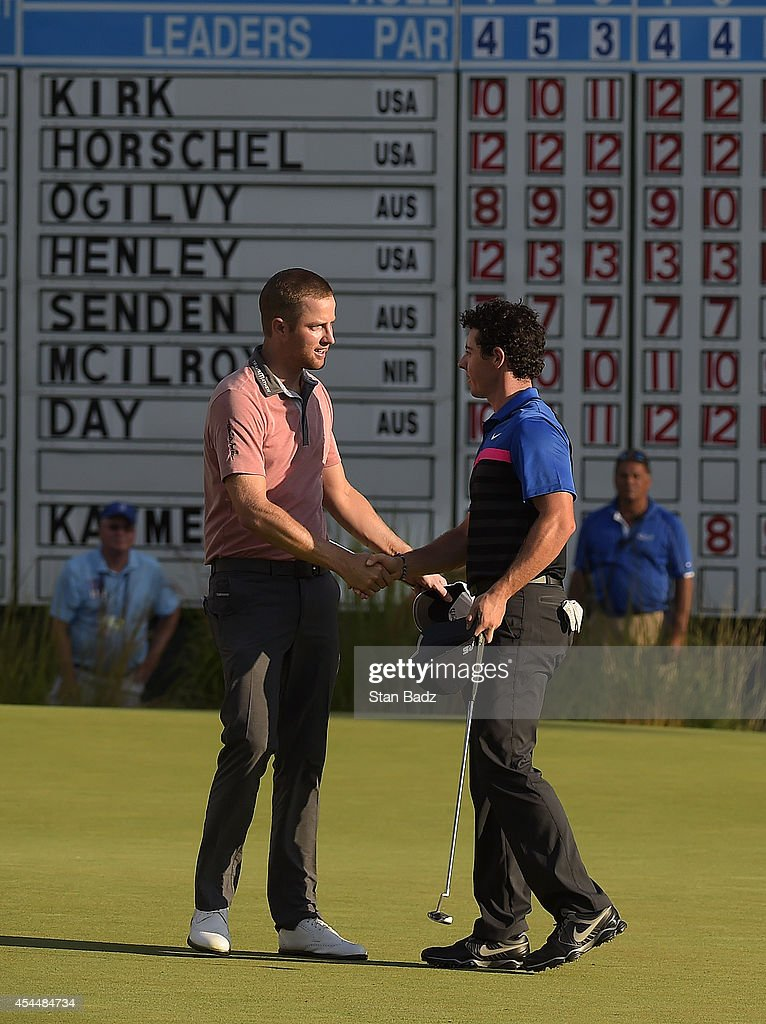 Chris Kirk of the United States shakes hands with Rory McIlroy of Northern Ireland on the 18th hole during the final round of the Deutsche Bank Championship at TPC Boston on September 1, 2014 in Norton, Massachusetts.