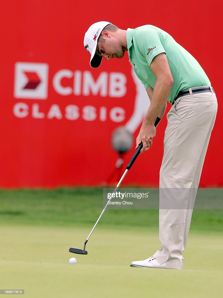 <a gi-track='captionPersonalityLinkClicked' href=/galleries/search?phrase=Chris+Kirk&family=editorial&specificpeople=3973095 ng-click='$event.stopPropagation()'>Chris Kirk</a> of USA putts on the 18th hole during round three of the CIMB Classic at Kuala Lumpur Golf & Country Club on October 26, 2013 in Kuala Lumpur, Malaysia.