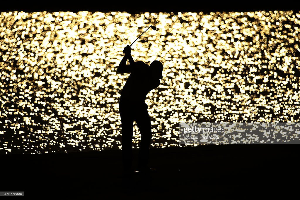 Chris Kirk plays his second shot on the 18th hole during round three of THE PLAYERS Championship at the TPC Sawgrass Stadium course on May 9 2015 in...