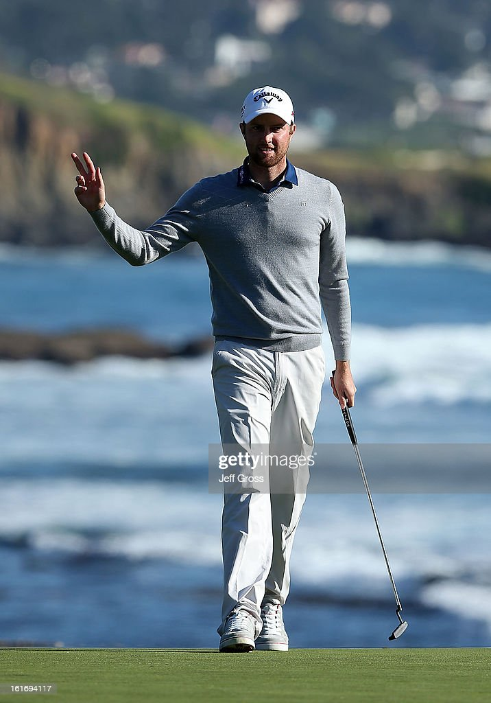 Chris Kirk waves to the gallery during the final round of the AT&T Pebble Beach National Pro-Am at Pebble Beach Golf Links on February 10, 2013 in Pebble Beach, California.
