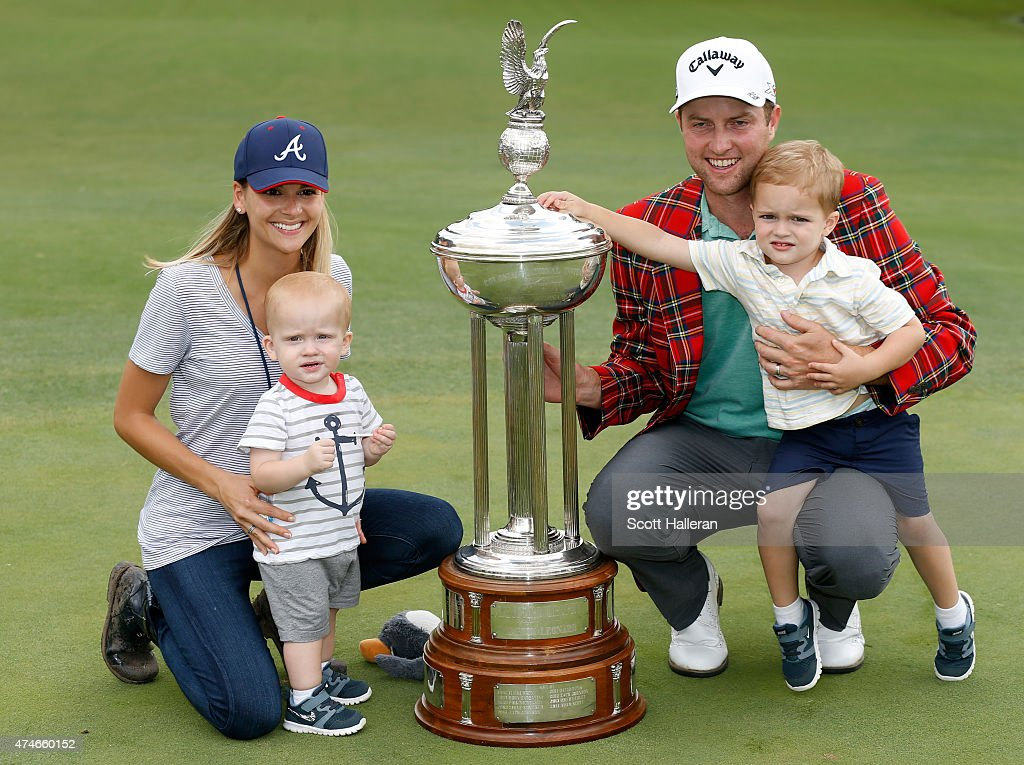 Chris Kirk wife Tahnee and sons Foster and Sawyer Kirk pose with the Leonard trophy during the final round of the Crowne Plaza Invitational at the...