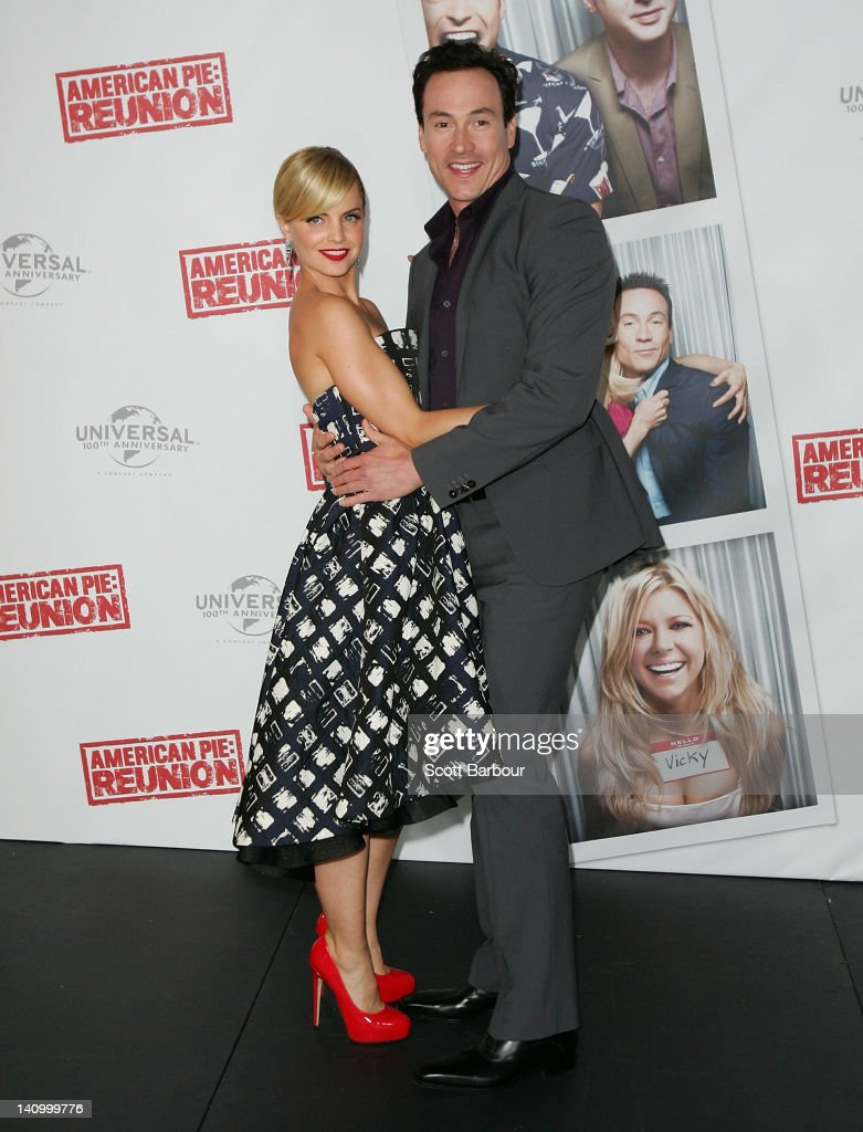 Chris Klein and Mena Suvari dance as they arrive at the Australian premiere of 'American Pie: Reunion' on March 7, 2012 in Melbourne, Australia.