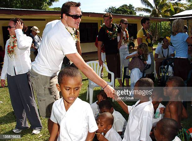 Chris Klein and village children during Kelly Slater Invitational Fiji Day 2 Mome Village Tour in Mome Village Tavarua Island Fiji
