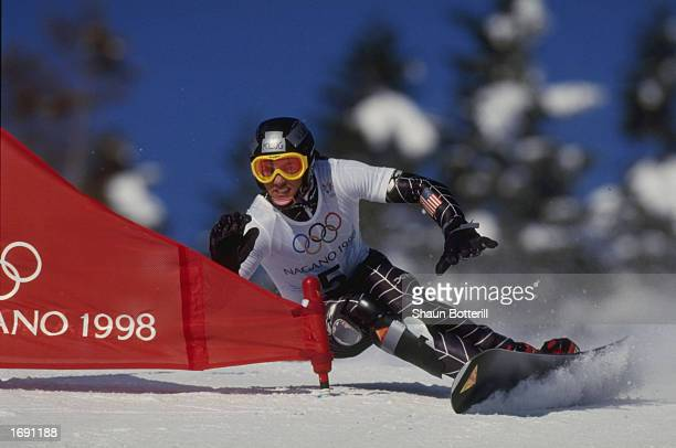 Chris Klug of the USA takes a turn in the Mens Giant Slalom during the Mens Snowboarding competition on Feburary 81998 in Shiga Kogen Japan during...
