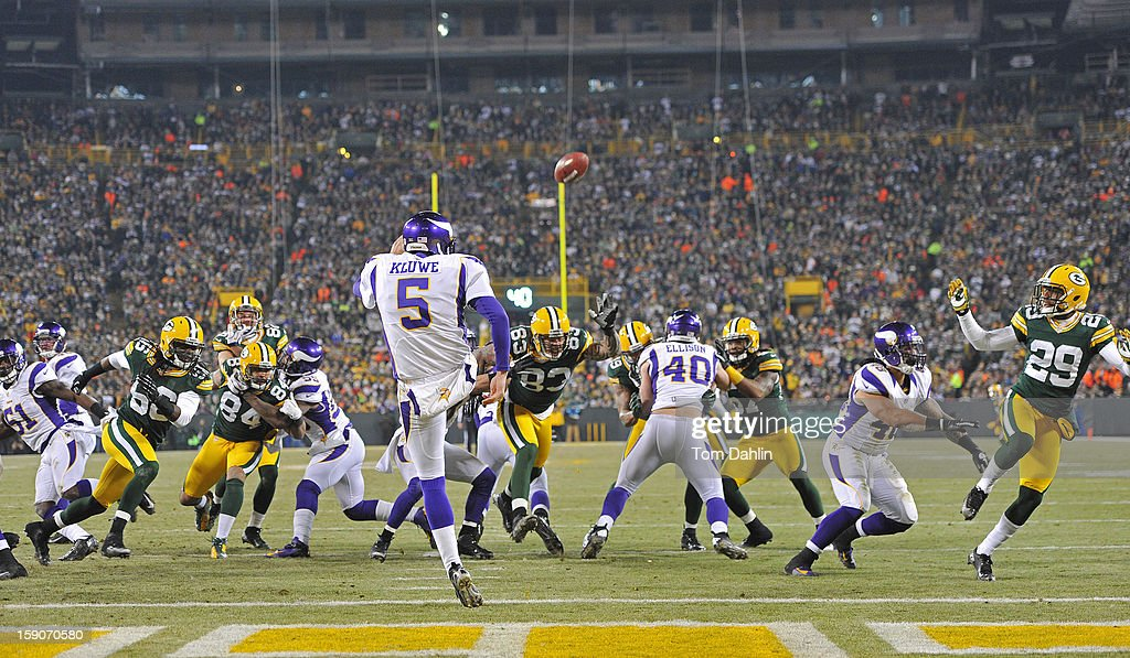 Chris Kluwe #5 of the Minnesota Vikings punts during an NFL game against the Green Bay Packers at Lambeau Field, January 5, 2013 in Green Bay, Wisconsin.