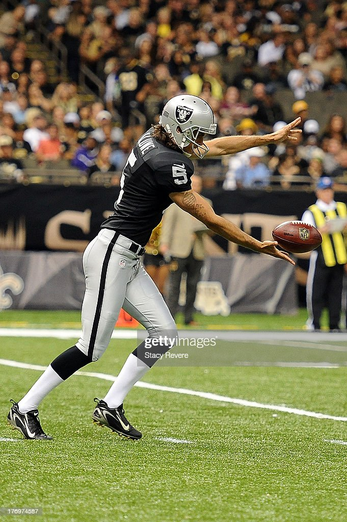 Chris Kluwe #5 of the Oakland Raiders prepares to punt against the New Orleans Saints during a preseason game at the Mercedes-Benz Superdome on August 16, 2013 in New Orleans, Louisiana. The Saints won 28-20.