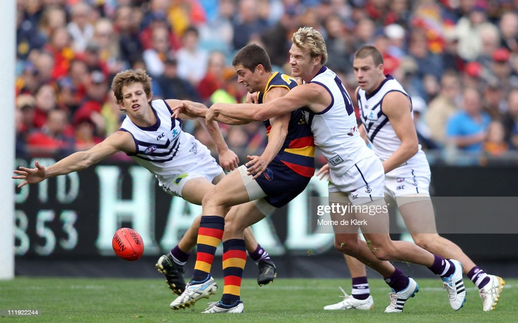 Chris Knights of the Crows kicks at goal under pressure during the round three AFL match between the Adelaide Crows and the Fremantle Dockers at AAMI Stadium on April 9, 2011 in Adelaide, Australia.