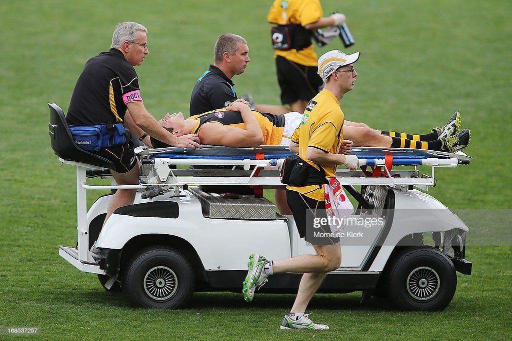 Chris Knights of the Tigers is taken from the field on a stretcher during the round seven AFL match between Port Adelaide Power and the Richmond Tigers at AAMI Stadium on May 11, 2013 in Adelaide, Australia.