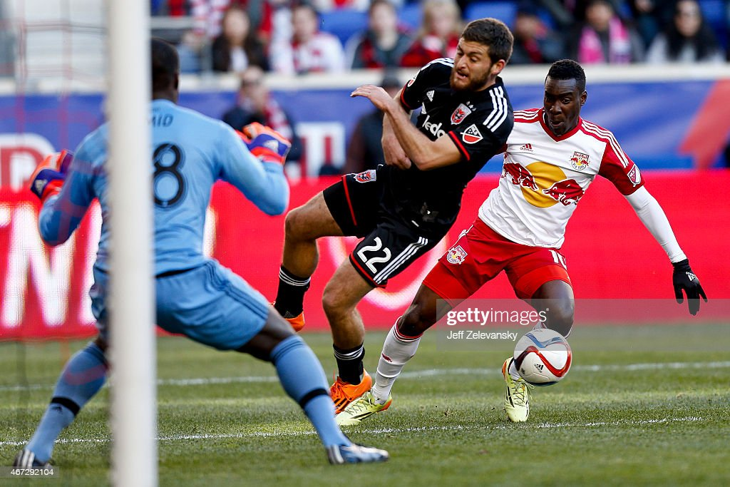 Chris Korb #22 and goalkeeper <a gi-track='captionPersonalityLinkClicked' href=/galleries/search?phrase=Bill+Hamid&family=editorial&specificpeople=4417249 ng-click='$event.stopPropagation()'>Bill Hamid</a> #28 of D.C. United defend against <a gi-track='captionPersonalityLinkClicked' href=/galleries/search?phrase=Lloyd+Sam&family=editorial&specificpeople=1001829 ng-click='$event.stopPropagation()'>Lloyd Sam</a> #10 of New York Red Bulls during their match at Red Bull Arena on March 22, 2015 in Harrison, New Jersey.