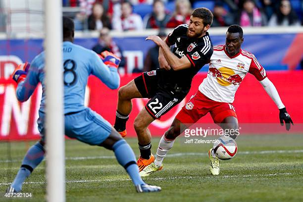 Chris Korb and goalkeeper Bill Hamid of DC United defend against Lloyd Sam of New York Red Bulls during their match at Red Bull Arena on March 22...