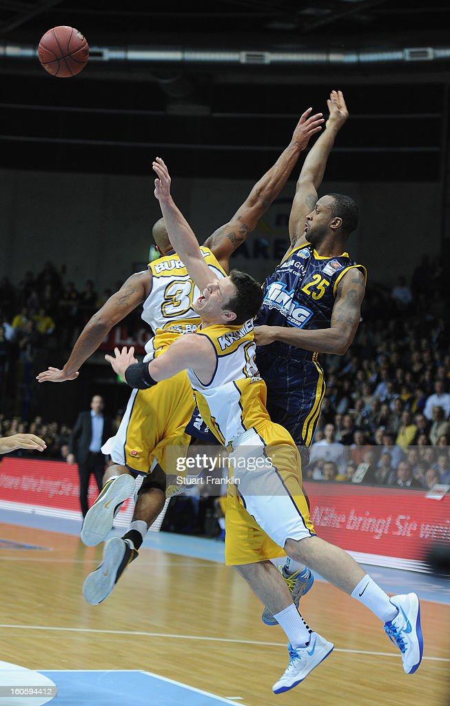 Chris Kramer of Oldenburg challenges for the ball with Jekel Foster of Berlin during the BBL game between EWE Baskets Oldenburg and Alba Berlin at the EWE arena on February 3, 2013 in Oldenburg in Holstein, Germany.