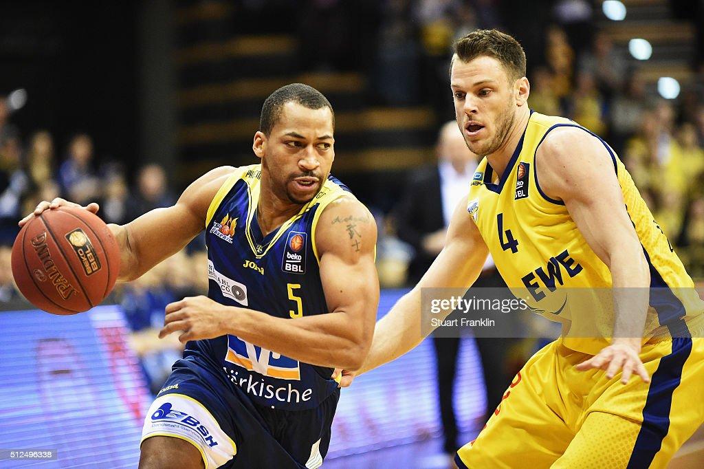 Chris Kramer of Oldenburg is challenged by David Bell of Hagen during the Bundesliga basketball match between EWE Baskets Oldenburg and Phoenix Hagen...