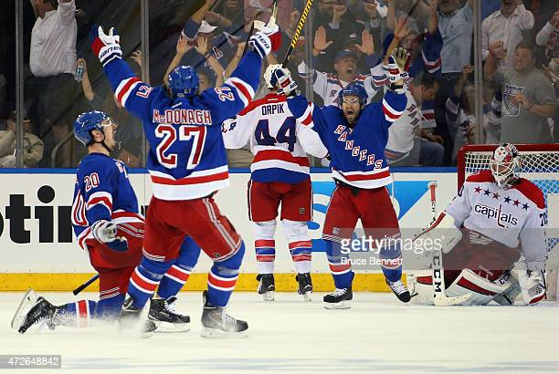 Chris Kreider celebrates his third period game tying goal against Braden Holtby of the Washington Capitals and is joined by Ryan McDonagh and Martin...