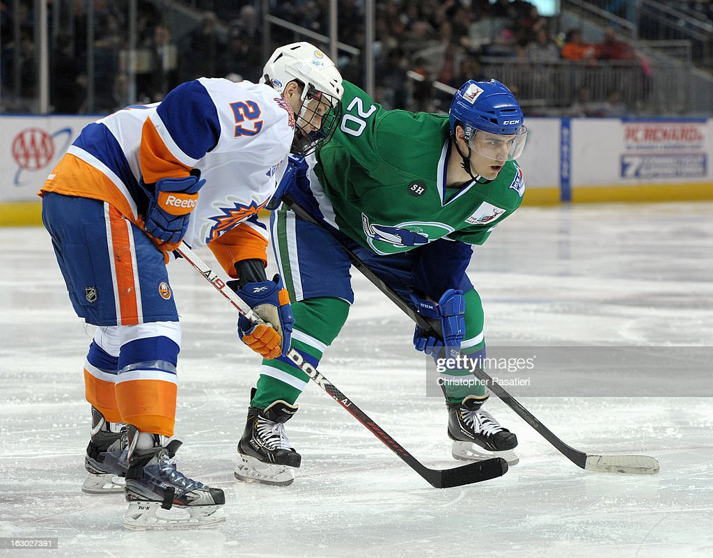 Chris Kreider #20 of the Connecticut Whale and Aaron Ness #27 of the Bridgeport Sound Tigers face off during an American Hockey League game on March 3, 2013 at the Webster Bank Arena at Harbor Yard in Bridgeport, Connecticut.