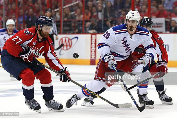 Chris Kreider of the New York Rangers and Karl Alzner of the Washington Capitals battle for the puck during the second period in Game Four of the...