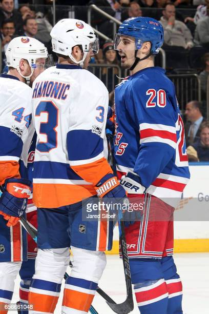 Chris Kreider of the New York Rangers and Travis Hamonic of the New York Islanders exchange words after a whistle in the third period at Madison...