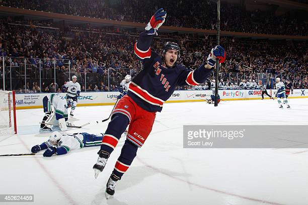 Chris Kreider of the New York Rangers celebrates a first period goal against the Vancouver Canucks at Madison Square Garden on November 30 2013 in...