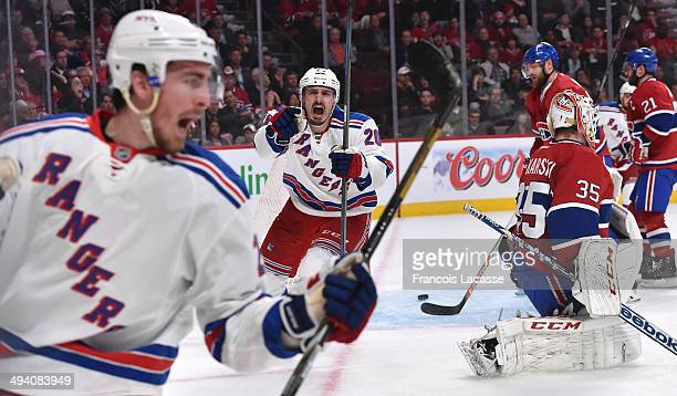 Chris Kreider of the New York Rangers celebrates after scoring a goal on goaltender Dustin Tokarski of the Montreal Canadiens in Game Five of the...