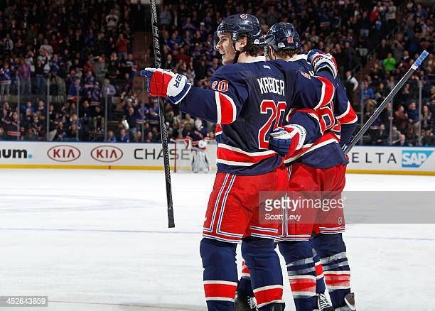 Chris Kreider of the New York Rangers celebrates after scoring his third goal of the game against the Vancouver Canucks at Madison Square Garden on...