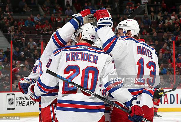 Chris Kreider of the New York Rangers celebrates his first period powerplay goal against the Ottawa Senators with team mate Kevin Hayes during an NHL...
