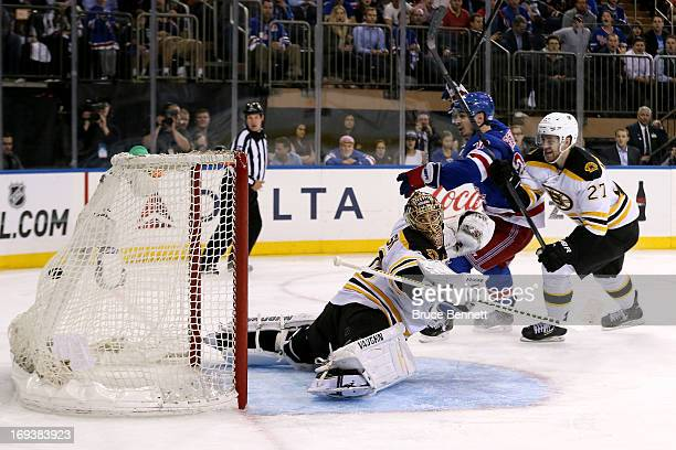Chris Kreider of the New York Rangers celebrates his gamewinning goal in overtime against goalie Tuukka Rask and Dougie Hamilton of the Boston Bruins...