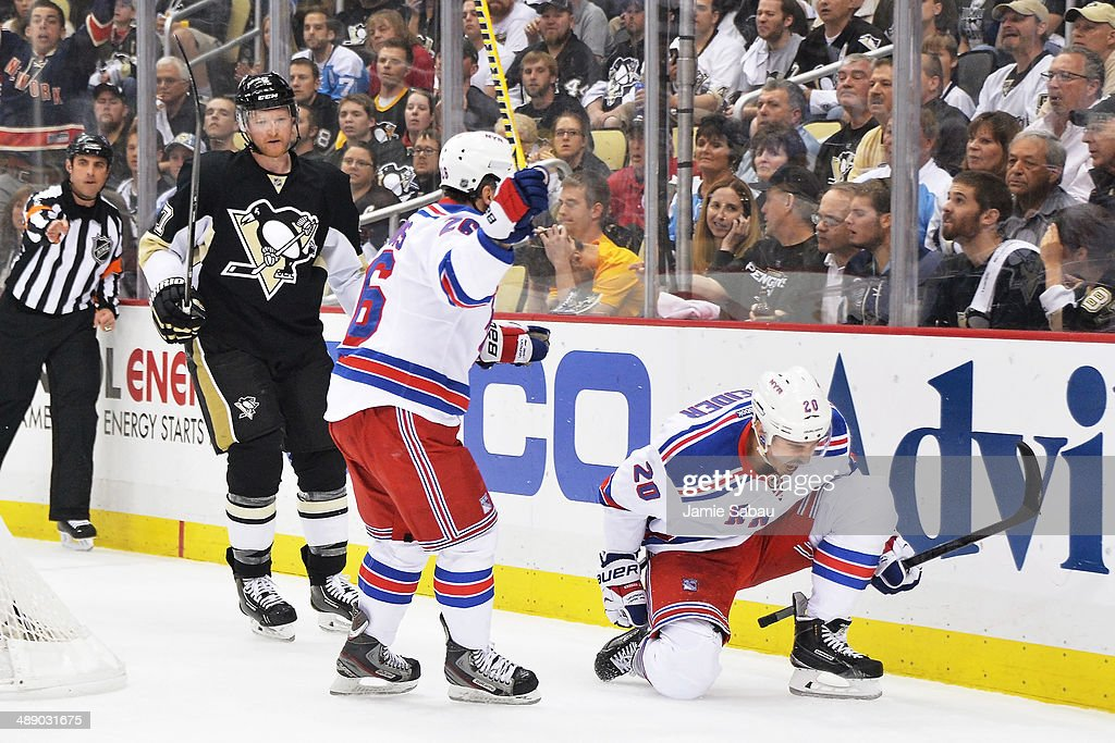 Chris Kreider #20 of the New York Rangers celebrates his power-play goal in the first period with Martin St. Louis #26 as Paul Martin #7 of the Pittsburgh Penguins skates by in Game Five of the Second Round of the 2014 NHL Stanley Cup Playoffs on May 9, 2014 at CONSOL Energy Center in Pittsburgh, Pennsylvania.