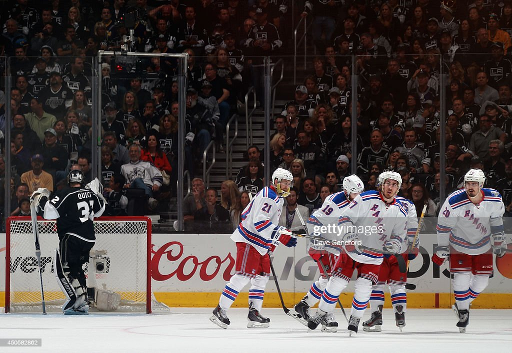 Chris Kreider #20 of the New York Rangers celebrates his second period goal with teammates as goaltender Jonathan Quick #32 of the Los Angeles Kings reacts during Game Five of the 2014 Stanley Cup Final at the Staples Center on June 13, 2014 in Los Angeles, California.