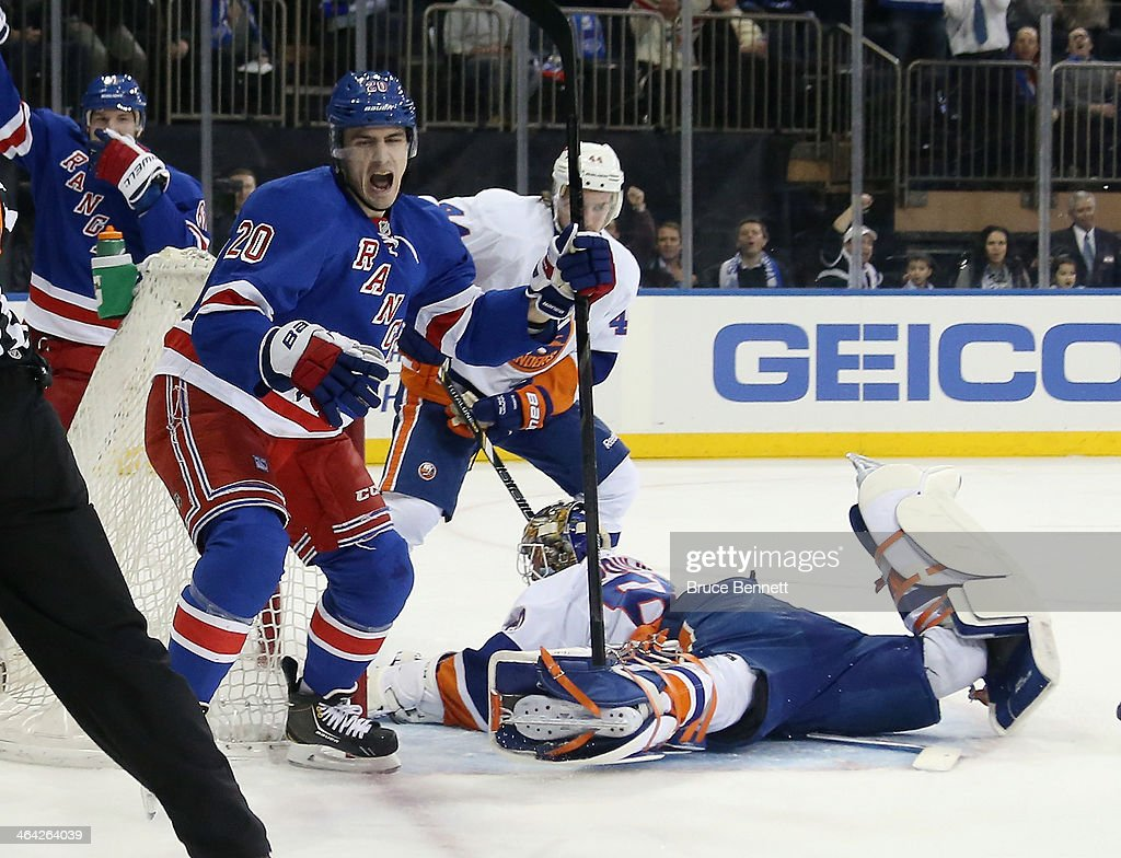 <a gi-track='captionPersonalityLinkClicked' href=/galleries/search?phrase=Chris+Kreider&family=editorial&specificpeople=5894671 ng-click='$event.stopPropagation()'>Chris Kreider</a> #20 of the New York Rangers celebrates his second period goal against <a gi-track='captionPersonalityLinkClicked' href=/galleries/search?phrase=Kevin+Poulin&family=editorial&specificpeople=4952456 ng-click='$event.stopPropagation()'>Kevin Poulin</a> #60 of the New York Islanders at Madison Square Garden on January 21, 2014 in New York City.