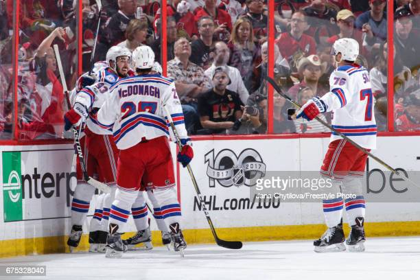 Chris Kreider of the New York Rangers celebrates his second period goal against the Ottawa Senators with teammates Mika Zibanejad Brady Skjei and...