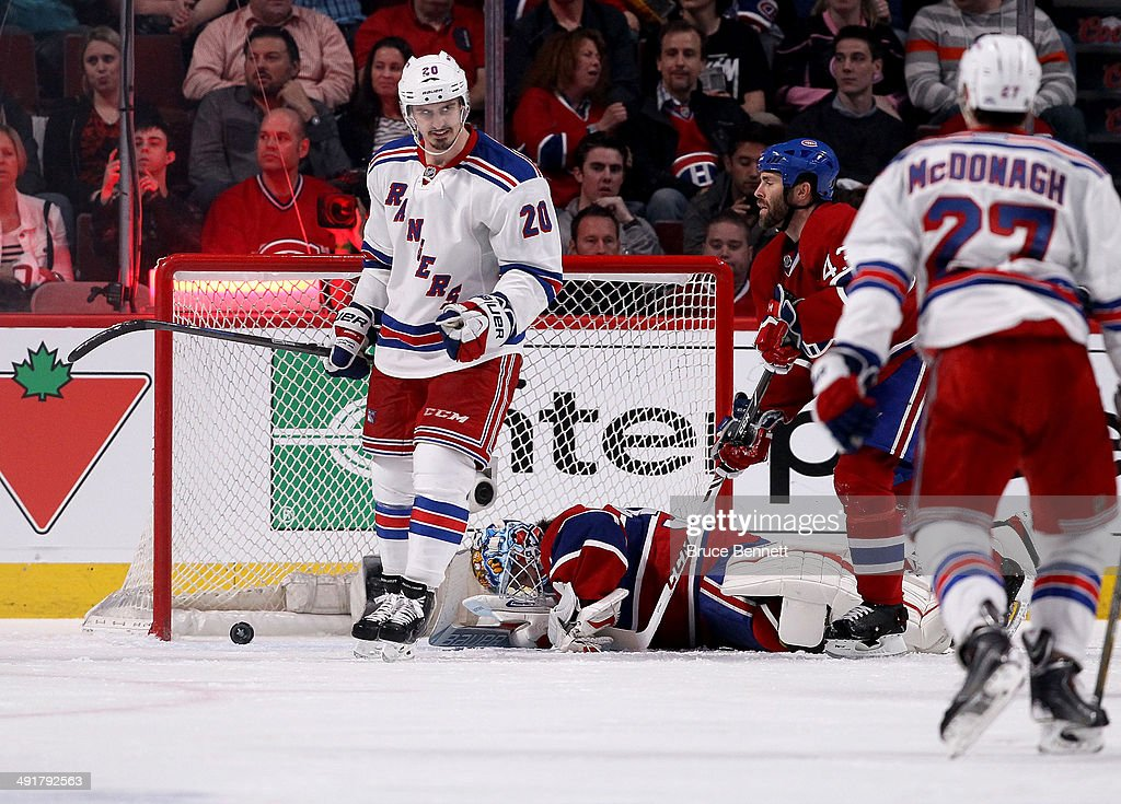 Chris Kreider #20 of the New York Rangers celebrates the goal by teammate Derek Stepan #21 in the third period against the Montreal Canadiens in Game One of the Eastern Conference Finals of the 2014 NHL Stanley Cup Playoffs at the Bell Centre on May 17, 2014 in Montreal, Canada.