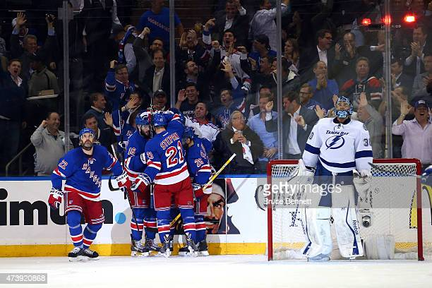 Chris Kreider of the New York Rangers celebrates with his teammates after scoring a goal in the first period against Ben Bishop of the Tampa Bay...